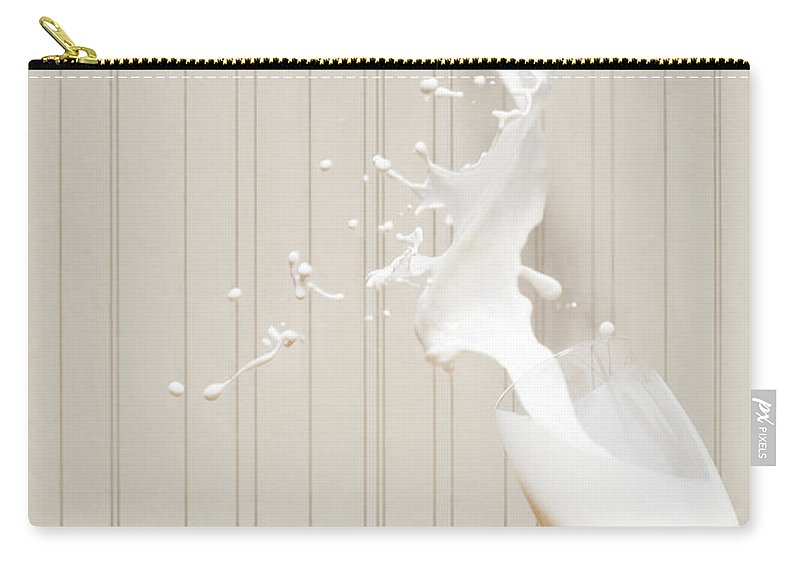 Milk Carry-all Pouch featuring the photograph Glas Of Milk Spilling by Henrik Sorensen