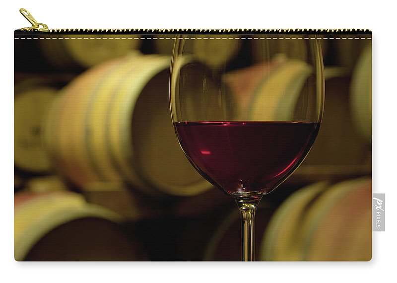 Stellenbosch Carry-all Pouch featuring the photograph Glass Of Red Wine In Wine Cellar by Siegfried Layda