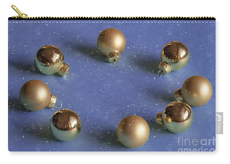 Decoration Carry-all Pouch featuring the photograph Golden Christmas Balls On The Snowy Background by Marina Usmanskaya