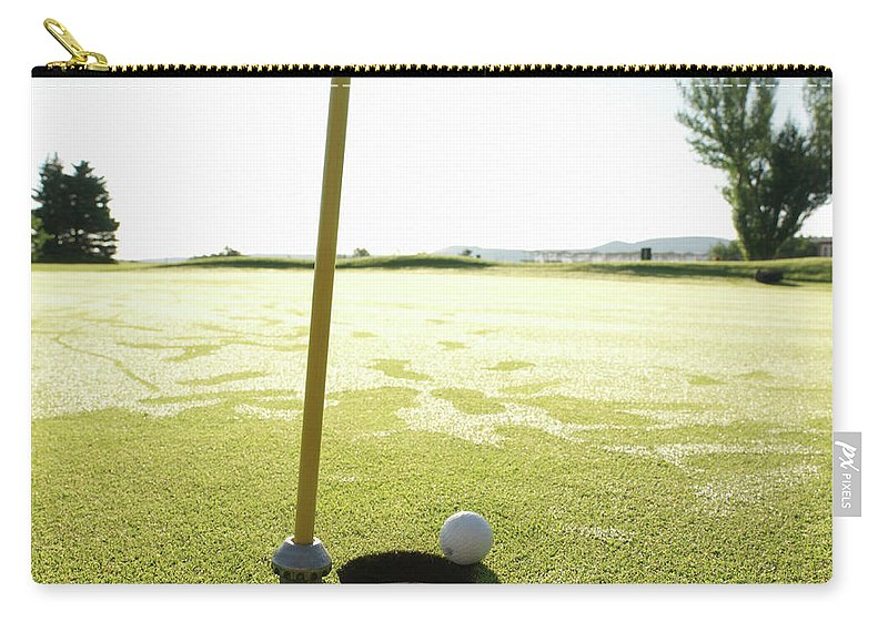 Grass Carry-all Pouch featuring the photograph Golf Ball Near Hole At Sunrise, High by Ascent/pks Media Inc.