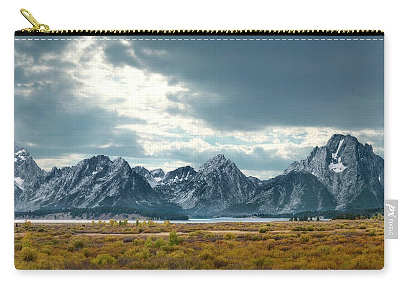 Scenics Carry-all Pouch featuring the photograph Grand Tetons In Dramatic Light by Ed Freeman