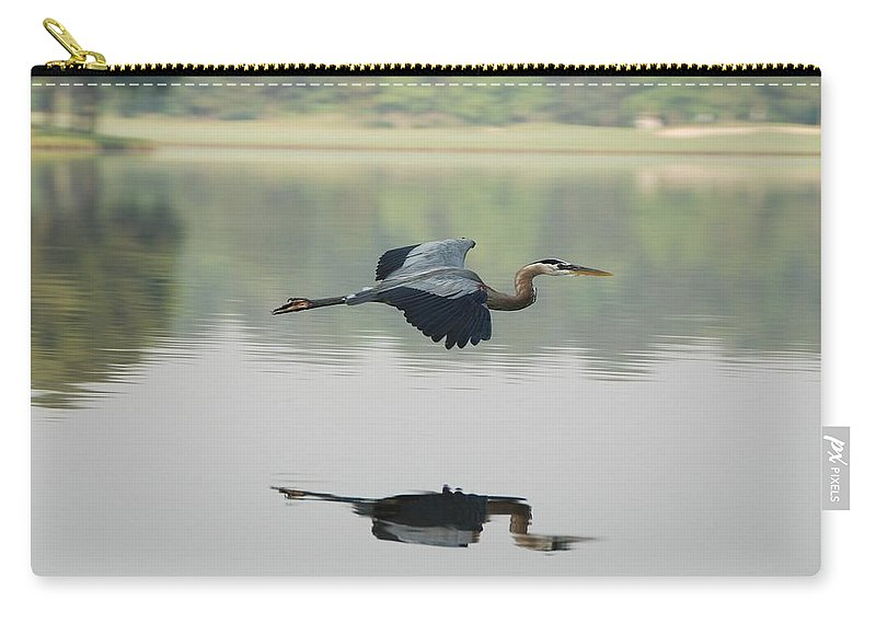 Animal Themes Carry-all Pouch featuring the photograph Great Blue Heron In Flight by Photo By Hannu & Hannele, Kingwood, Tx