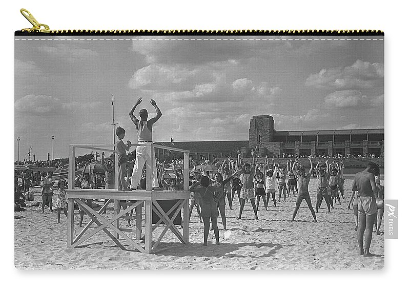 Human Arm Carry-all Pouch featuring the photograph Group Of People Exercising On Beach, B&w by George Marks