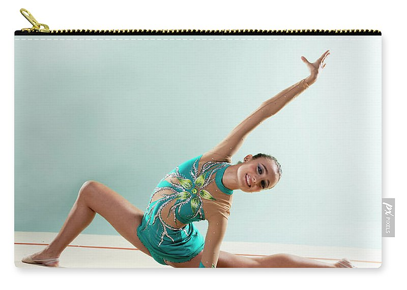 Human Arm Carry-all Pouch featuring the photograph Gymnast, Smiling, Bending Backwards by Emma Innocenti