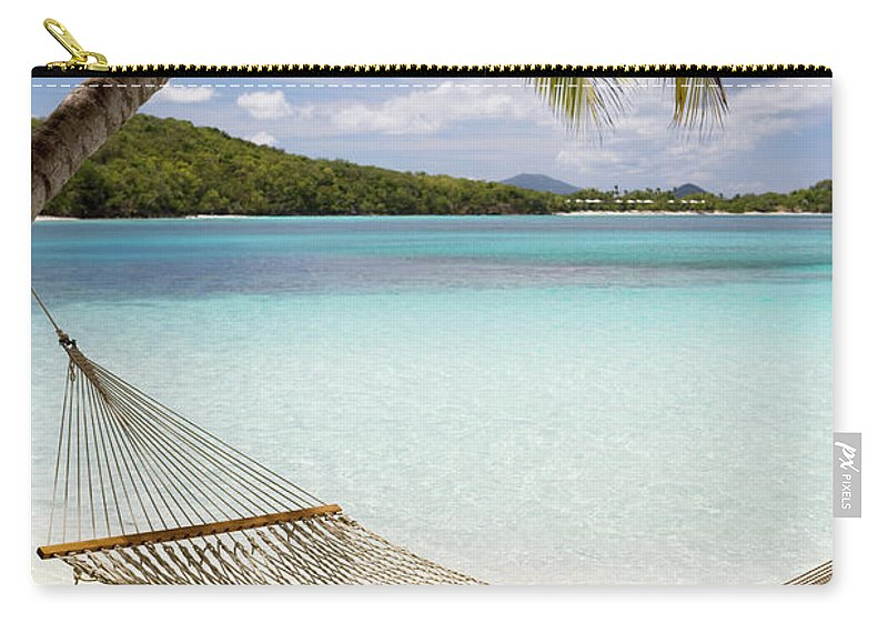 Water's Edge Carry-all Pouch featuring the photograph Hammock Hung On Palm Trees On A by Cdwheatley