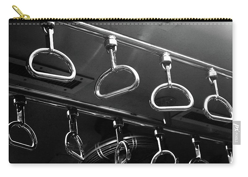 Handle Carry-all Pouch featuring the photograph Handles Inside Mumbai Local Train by Riteshsaini