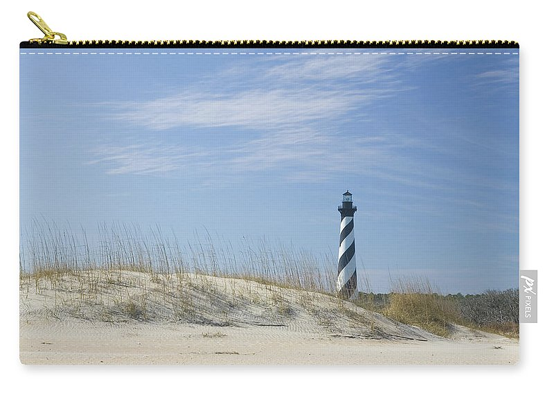 North Carolina Carry-all Pouch featuring the photograph Hatteras Lighthouse And The Dunes by Myhrcat