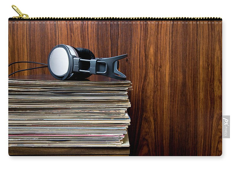 Technology Carry-all Pouch featuring the photograph Headphones Laying On Stack Of Vinyl by Steven Errico