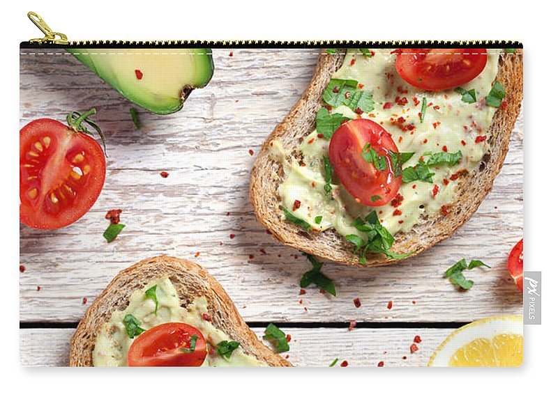 Breakfast Carry-all Pouch featuring the photograph Healthy Whole Grain Bread With Avocado by Barcin
