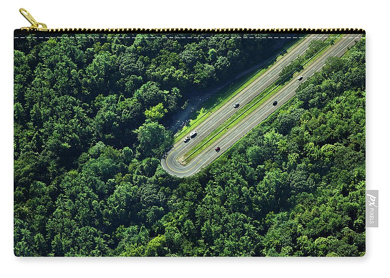 The End Carry-all Pouch featuring the photograph Highway U-turn In Forest by Thomas Jackson
