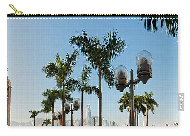 Chinese Culture Carry-all Pouch featuring the photograph Hong Kong Clock Tower Ferry Terminal by Fotovoyager