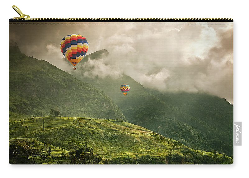Tranquility Carry-all Pouch featuring the photograph Hot Air Balloons Over Tea Plantations by Nicolo Sertorio