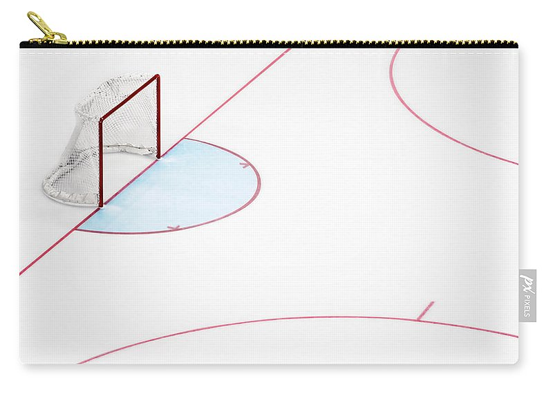 Sport Carry-all Pouch featuring the photograph Ice Hockey Goal Net And Empty Rink by David Madison