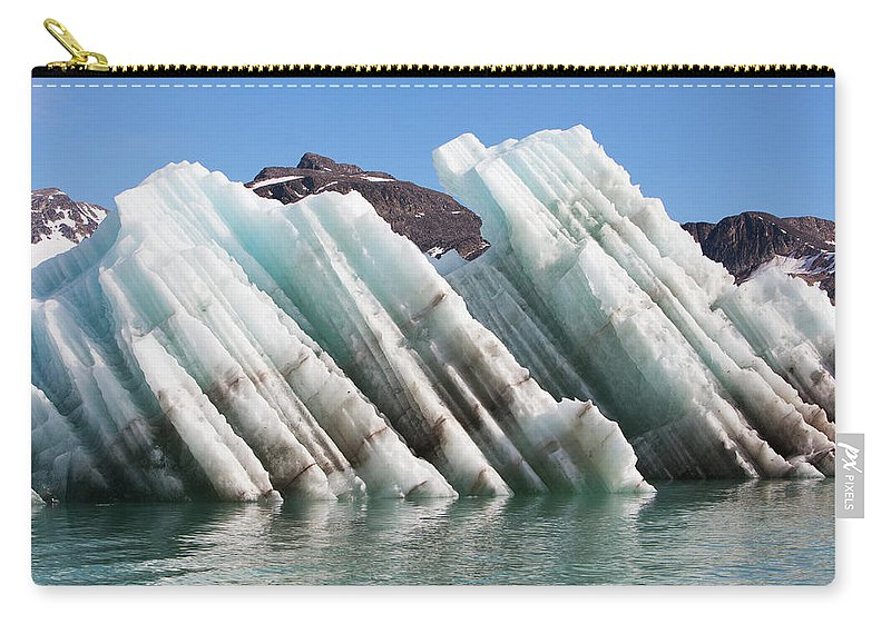 Iceberg Carry-all Pouch featuring the photograph Iceberg Streaked With Rock Debris by Anna Henly