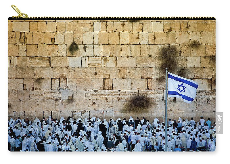 Crowd Carry-all Pouch featuring the photograph Israeli Flag Flies At The Western Wall by Gary S Chapman