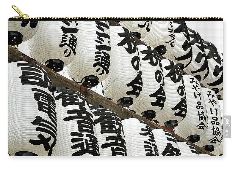 Pole Carry-all Pouch featuring the photograph Japanese Paper Lanterns In Preparation by Britta Wendland