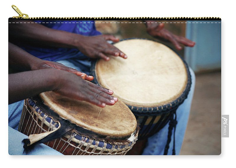 People Carry-all Pouch featuring the photograph Jembe Players by Peeterv