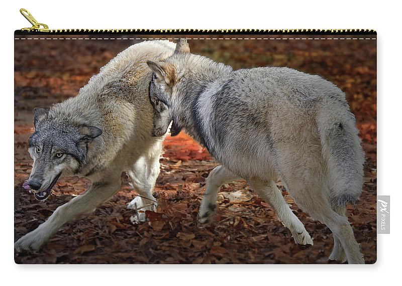 Wolf Carry-all Pouch featuring the photograph Joyful Wolves by Jeannee Gannuch