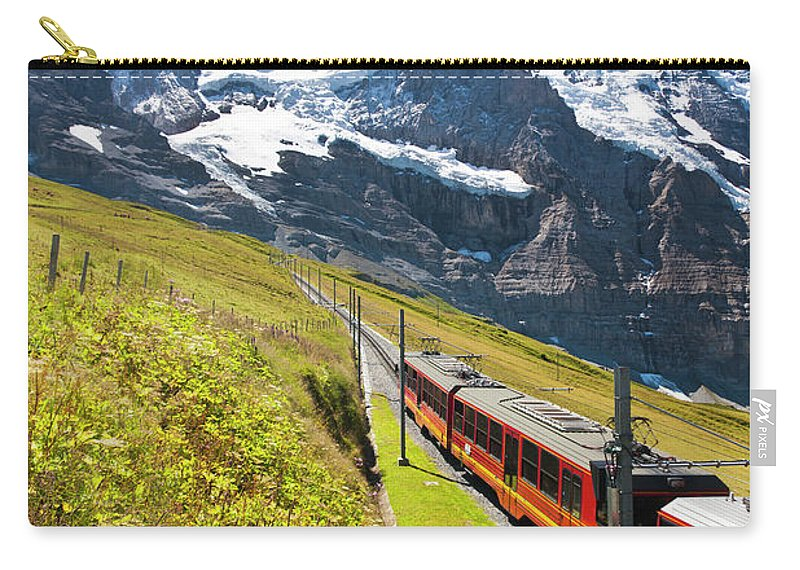 Scenics Carry-all Pouch featuring the photograph Jungfraubahn, Swiss Alps by Michaelutech