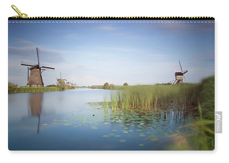Tranquility Carry-all Pouch featuring the photograph Landscape With Windmills, Kinderdijk by Frank De Luyck