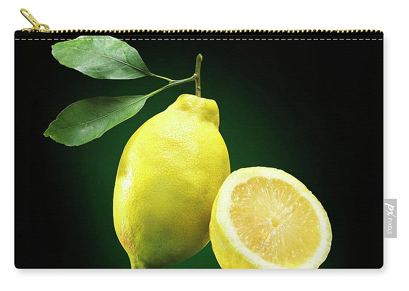 Black Background Carry-all Pouch featuring the photograph Lemon Slice by Jeremy Hudson