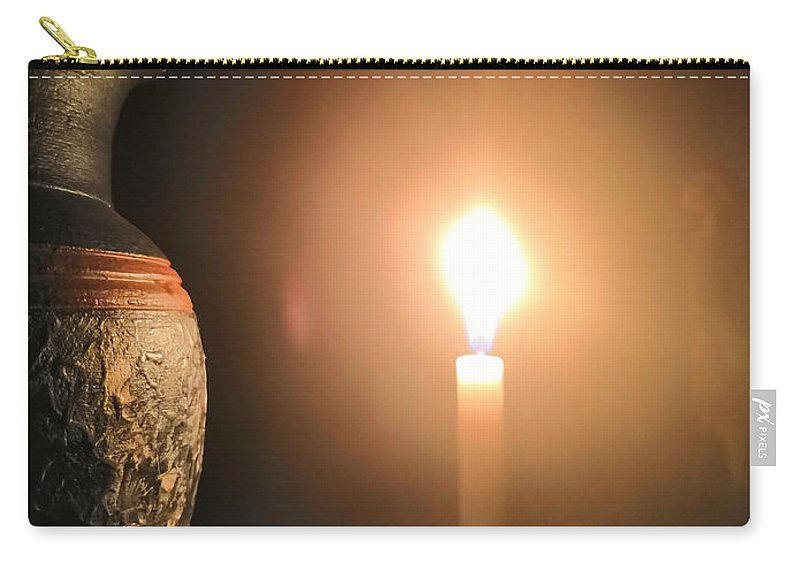 Candle Light Carry-all Pouch featuring the photograph Light in the dark by Ian Batanda