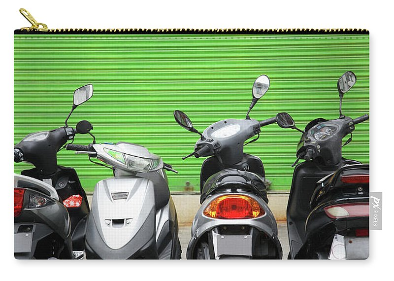 Macao Carry-all Pouch featuring the photograph Line Of Motorbikes Against Green by Steven Puetzer