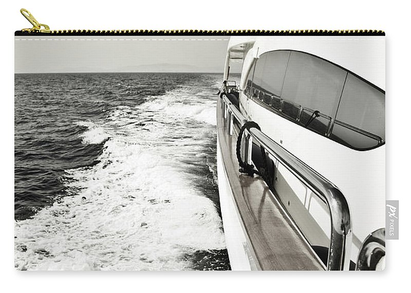Desaturated Carry-all Pouch featuring the photograph Luxury Yacht Sailing At High Speed In by Petreplesea