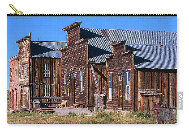 Grass Carry-all Pouch featuring the photograph Main Street Buildings At Bodie Historic by John Elk Iii