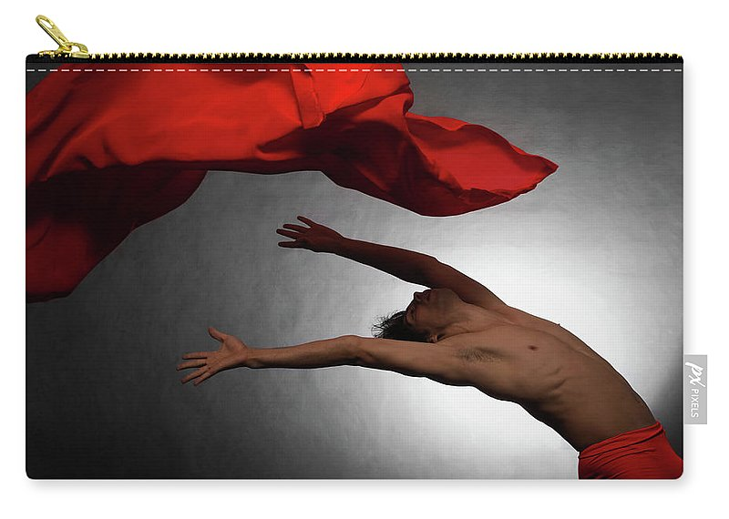 Ballet Dancer Carry-all Pouch featuring the photograph Male Ballet Dancer Dancing With A Red by Win-initiative/neleman