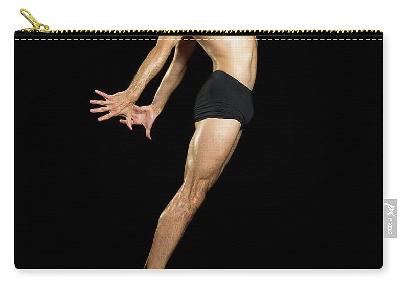 Human Arm Carry-all Pouch featuring the photograph Male Dancer Jumping by Image Source
