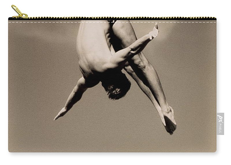 Diving Into Water Carry-all Pouch featuring the photograph Male Diver In Mid-air by David Madison