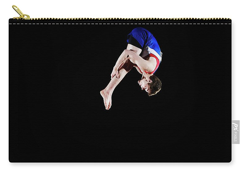 Focus Carry-all Pouch featuring the photograph Male Gymnast 16-17 Mid Air, Black by Thomas Barwick