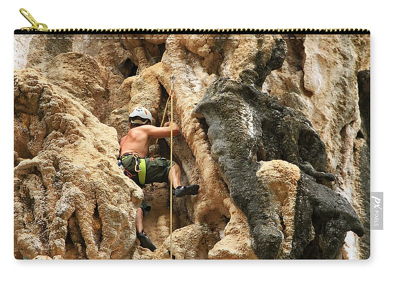 Sports Helmet Carry-all Pouch featuring the photograph Man Climbing Rock by Nisa And Ulli Maier Photography