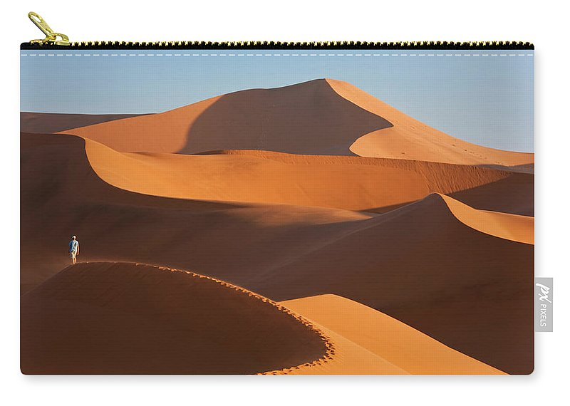 Shadow Carry-all Pouch featuring the photograph Man Climbing Sand Dunes, Namib Desert by Peter Adams