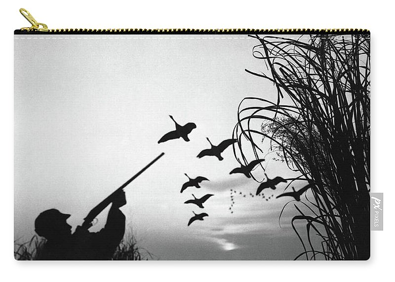 Rifle Carry-all Pouch featuring the photograph Man Duck-hunting by Stockbyte