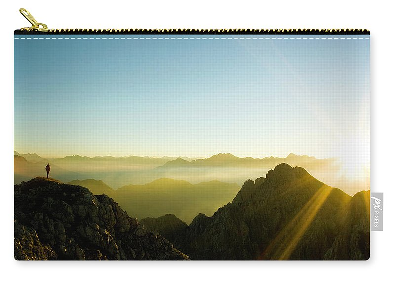 Dawn Carry-all Pouch featuring the photograph Man by Lopurice