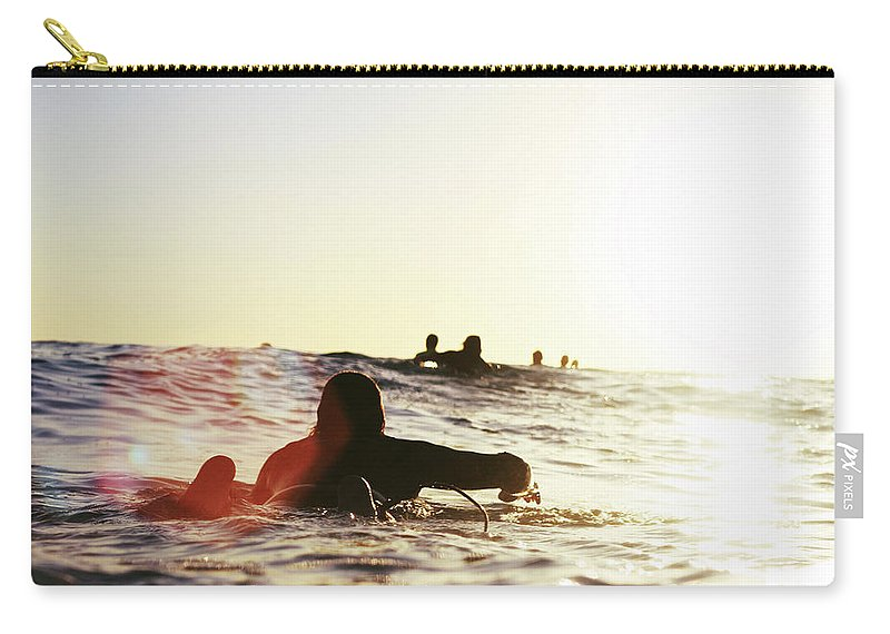 People Carry-all Pouch featuring the photograph Man On Surfer Paddle by Photography By Jack De La Mare. 2012