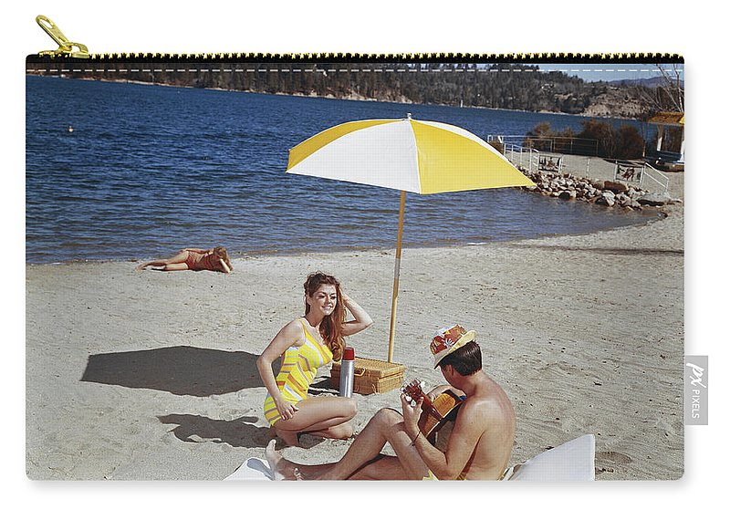 People Carry-all Pouch featuring the photograph Man Playing Guitar While Woman Dancing by Tom Kelley Archive
