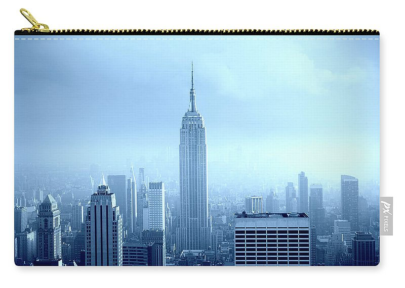 Lower Manhattan Carry-all Pouch featuring the photograph Manhattan Skyline In The Fog, Nyc. Blue by Lisa-blue