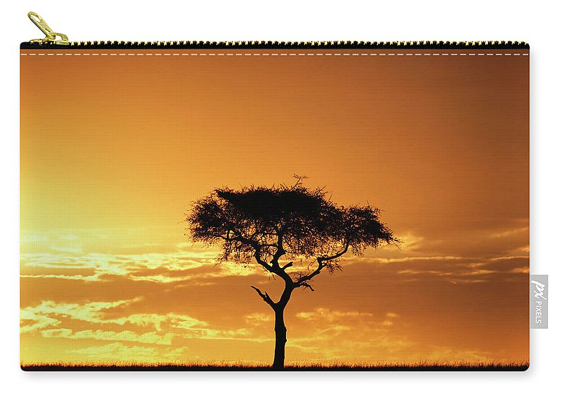 Tranquility Carry-all Pouch featuring the photograph Masai Mara National Game Reserve, Kenya by William Manning
