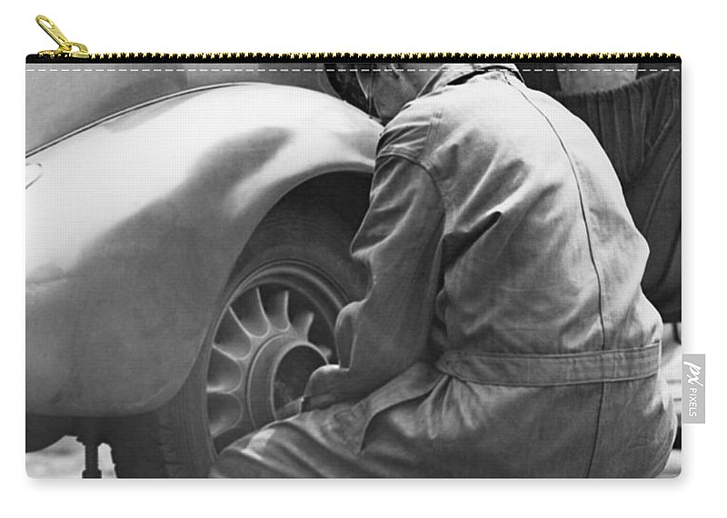 Working Carry-all Pouch featuring the photograph Mechanic Changing Tire On Car by George Marks
