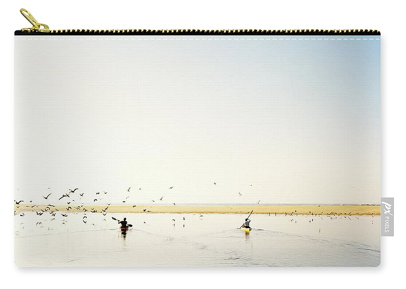 People Carry-all Pouch featuring the photograph Men Paddling Kayaks To The Beach by Julien Capmeil