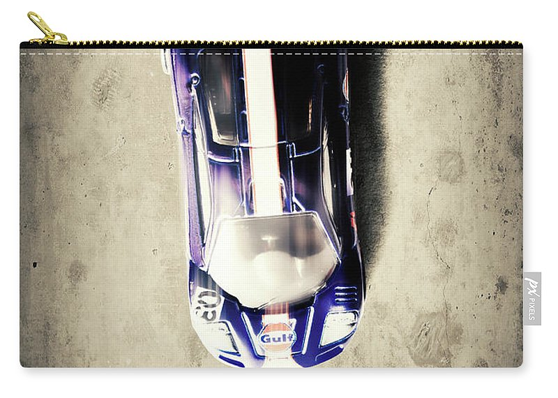 Toy Carry-all Pouch featuring the photograph Mini Racer by Jorgo Photography - Wall Art Gallery