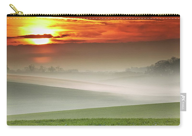 Tranquility Carry-all Pouch featuring the photograph Mist Over Landscape Of Rolling Hills by Andy Freer