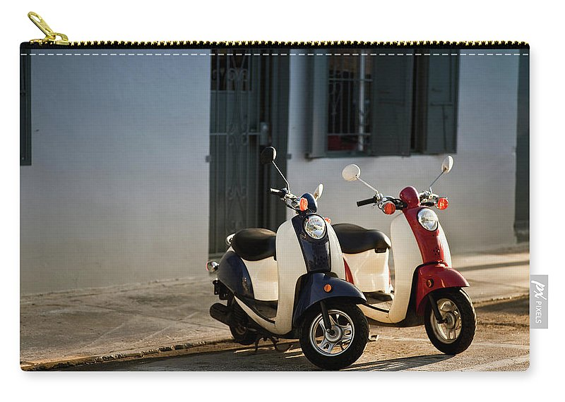 In A Row Carry-all Pouch featuring the photograph Motorbikes Parked On The Road by Pgiam