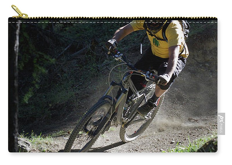 Sports Helmet Carry-all Pouch featuring the photograph Mountain Biker On Dirt Path by Michael Truelove