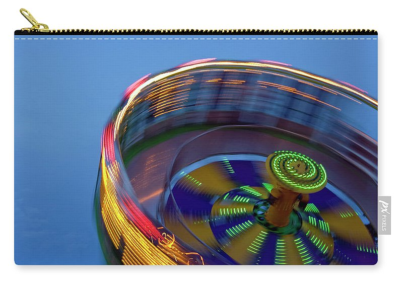 Carousel Carry-all Pouch featuring the photograph Multicolored Spinning Carnival Ride by By Ken Ilio