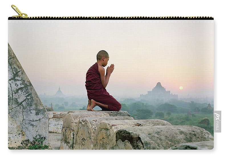 Child Carry-all Pouch featuring the photograph Myanmar, Bagan, Buddhist Monk Praying by Martin Puddy