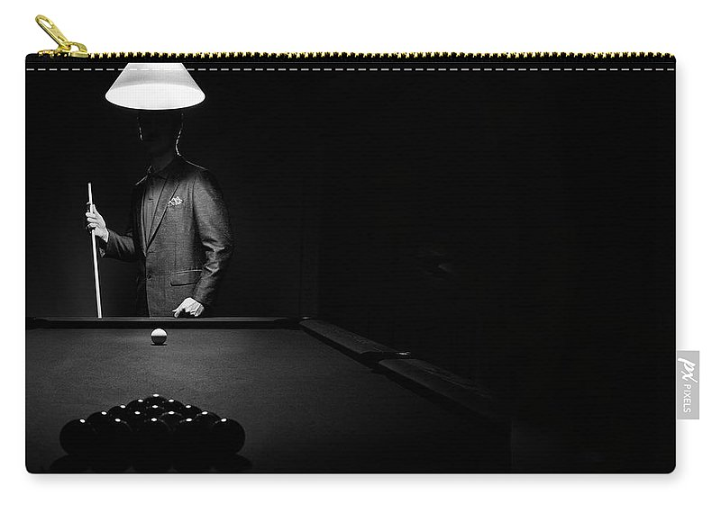 Mature Adult Carry-all Pouch featuring the photograph Mystery Pool Player Behind Rack Of by Design Pics / Richard Wear
